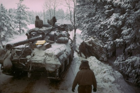 American Sherman M4 tank moves past another gun carriage which slid off icy road in the Ardennes Forest during push to halt advancing German troops in what was to become known as the Battle of the Bulge, the last major German offensive of WWII . (Photo by George Silk//Time Life Pictures/Getty Images)