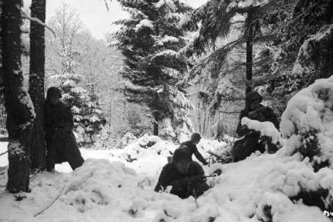 American infantrymen from the 290th Regiment crouch in the snowy woods near Amonines, Belgium, January 4, 1945. (Photo by US Army/Time & Life Pictures/Getty Images)